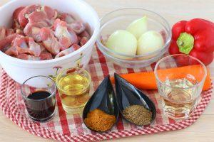 Острый салат из куриных желудочков